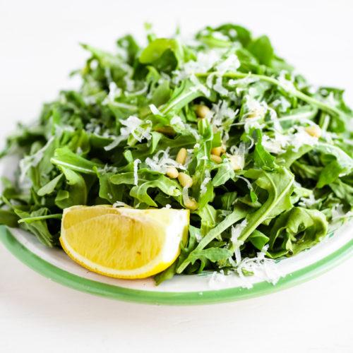 Baby Arugula Salad with Lemon, Balsamic Vinegar, Parmesan, and Pine Nuts