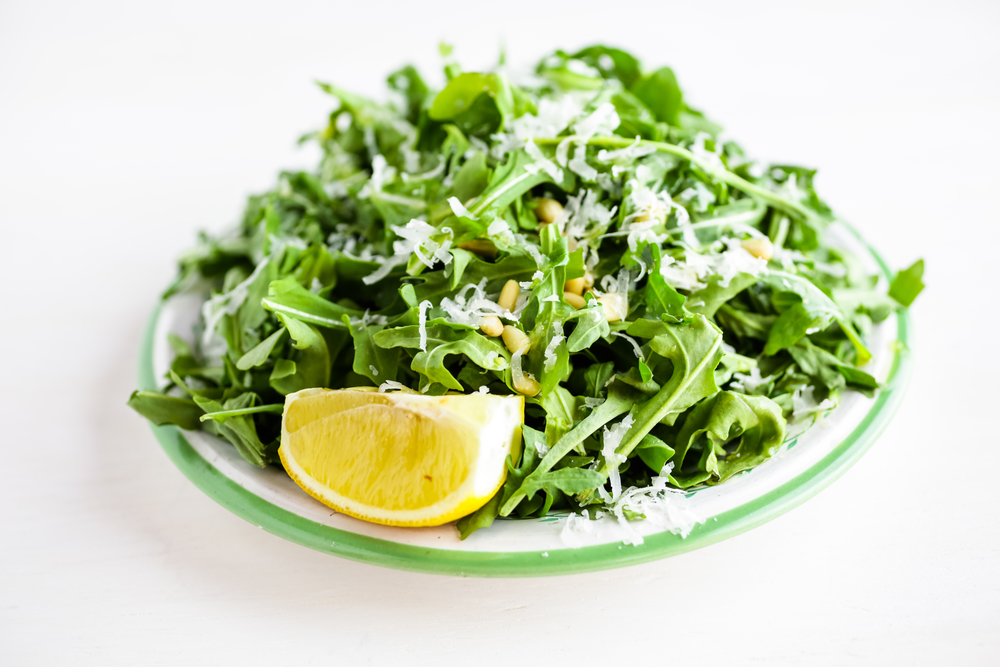 Depositphotos 74633691 m 2015 Baby Arugula Salad with Lemon, Balsamic Vinegar, Parmesan, and Pine Nuts