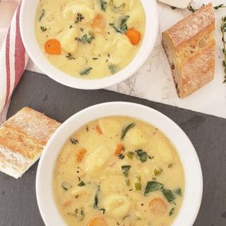 Italian Creamy Gnocchi and Vegetable Soup Recipe served in two bowls along with crusty bread Easy $5 Dinners to Feed a Family of Four