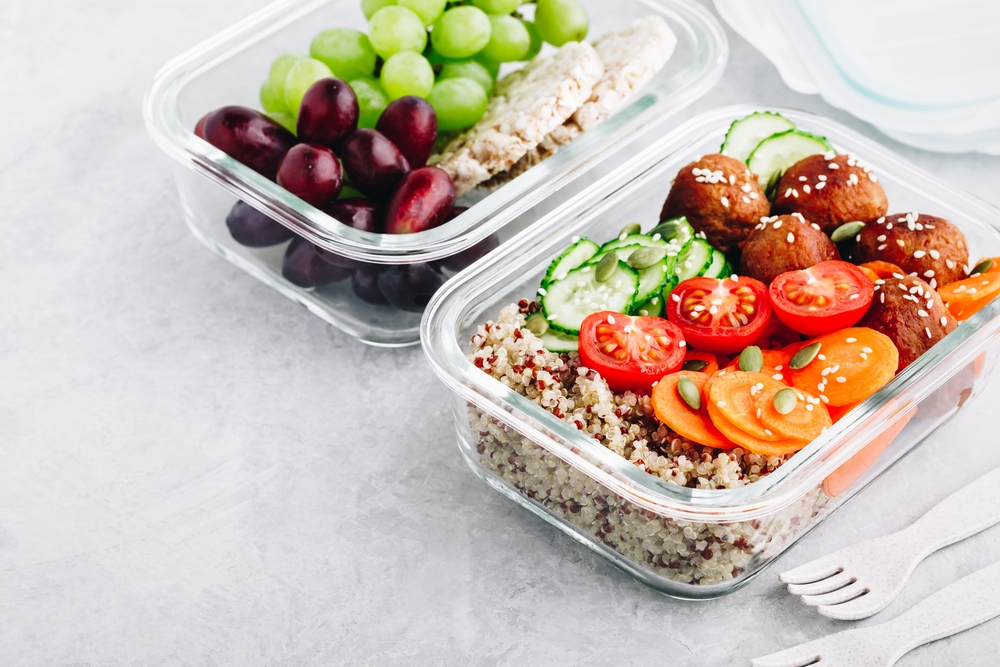 ground turkey meal prep meatballs, with sliced tomatoes and grapes