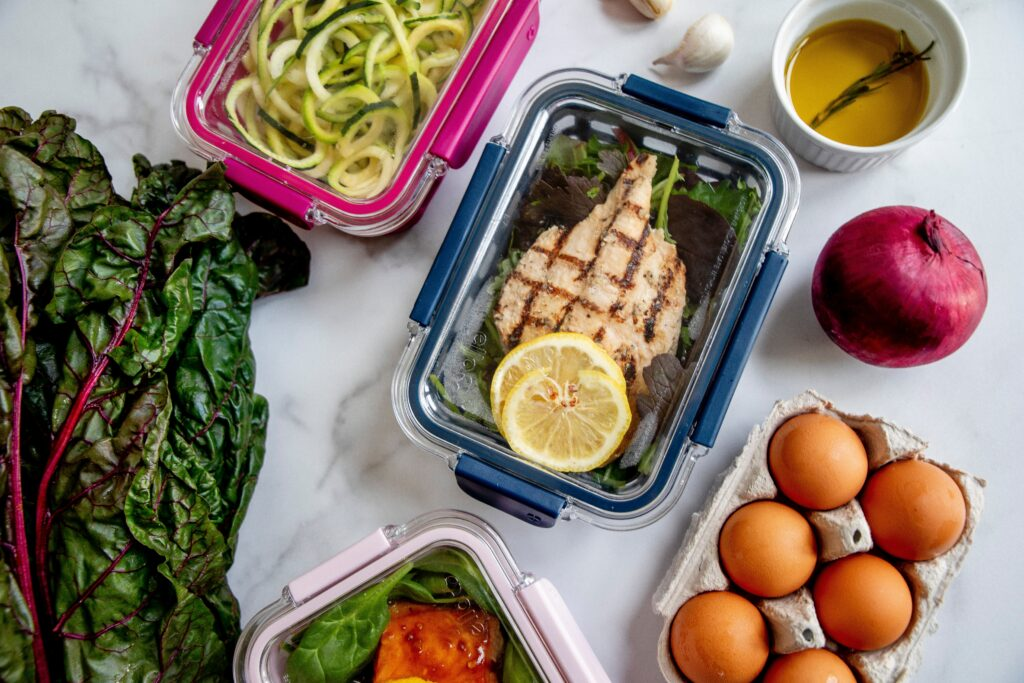 low carb meal prep with eggs, zucchini noodles and grilled chicken