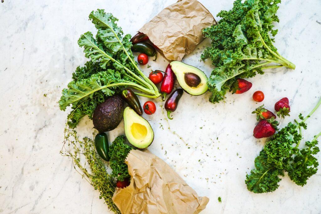 an assortment of veggies like avocado, kale and tomatoes